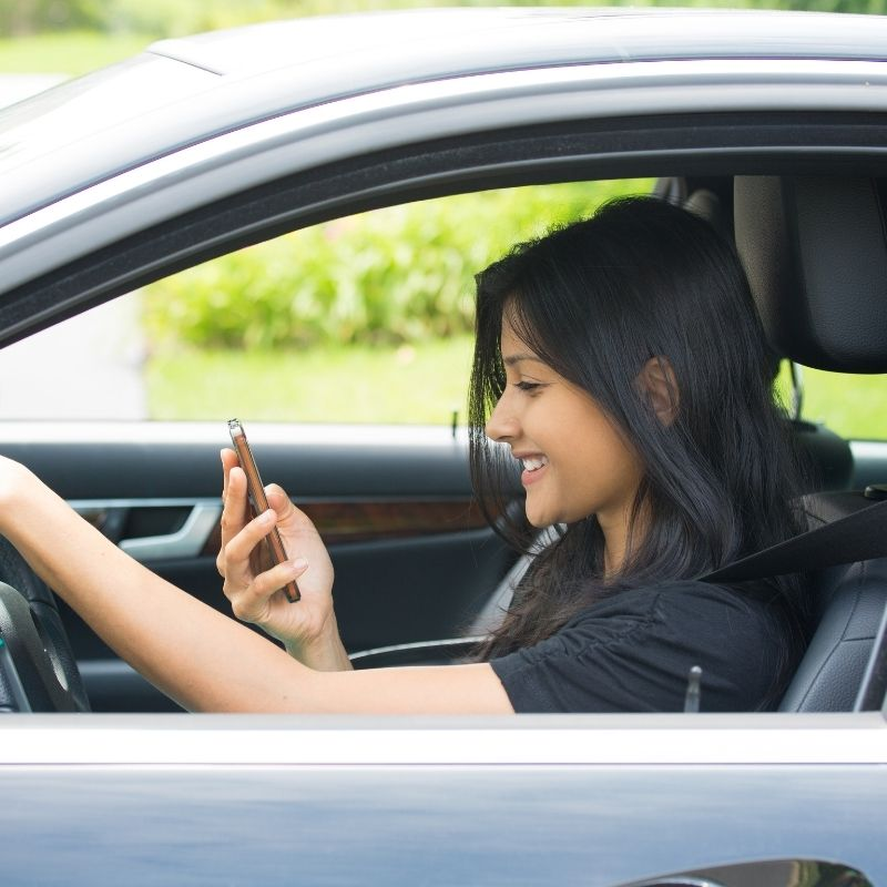 can you text while stopped at a red light